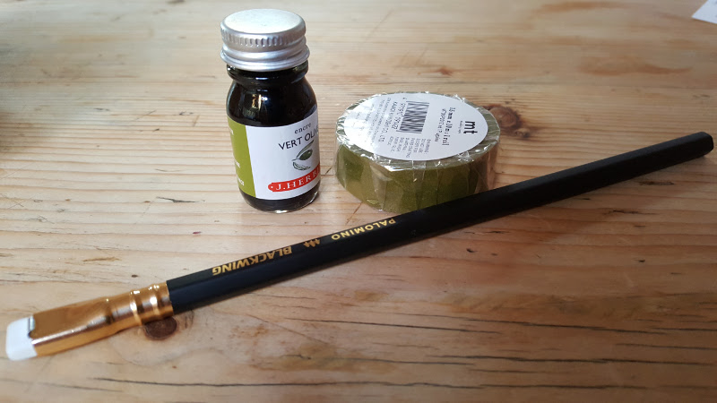 Palomino blackwing, ollive green washi tape and olive green ink.